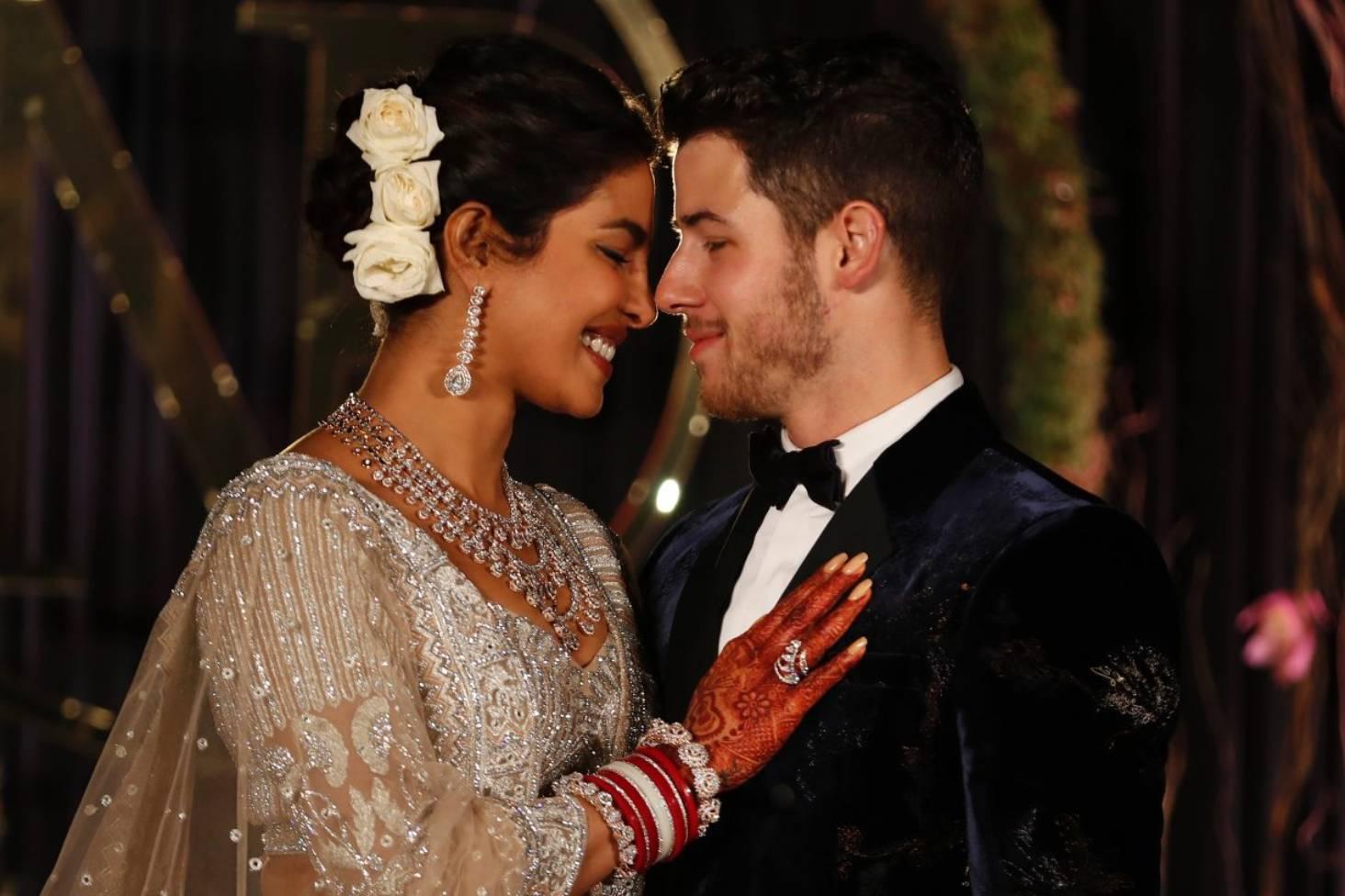 d5cce28c69 See Priyanka Chopra s stunning Ralph Lauren wedding dress and 23-metre veil