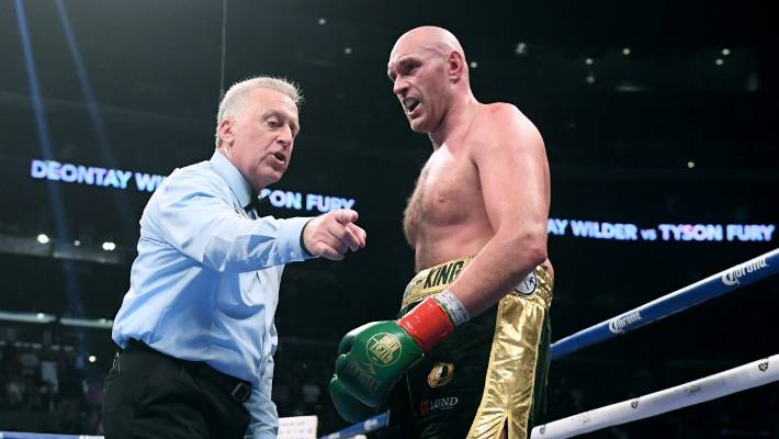 Referee Jack Reiss dishes out orders to Tyson Fury after the British fighter was floored by Deontay Wilder