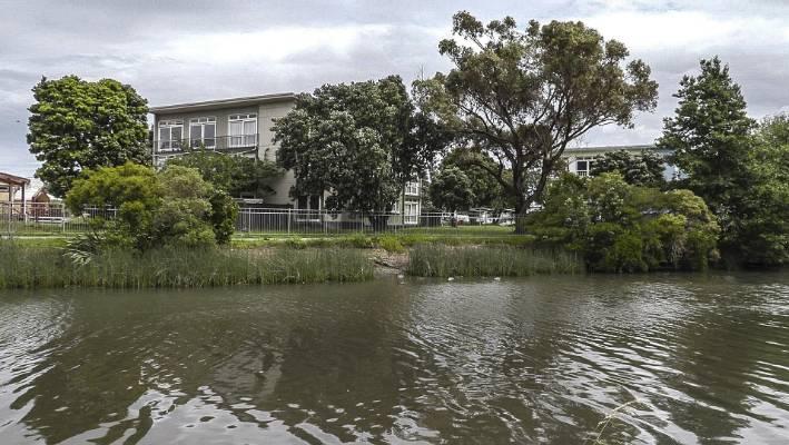 The foul smelling Te Mone Stream runs behind the Jackson Street Housing NZ flats in Petone.