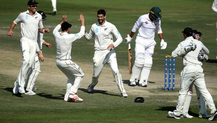Rookie spinner Will Somerville celebrates with team-mates after dismissing Haris Sohail.