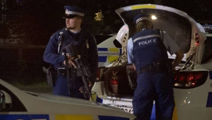 Armed police at the scene of a double stabbing in Mt Roskill, Auckland.