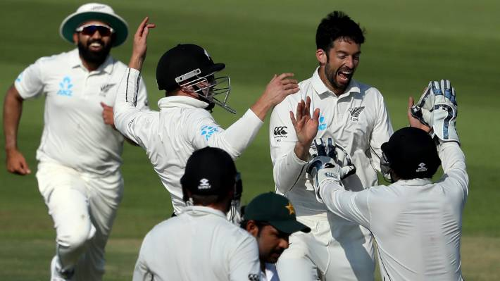 Will Somerville celebrates another of his seven wickets, this time it's Sarfraz Ahmed.