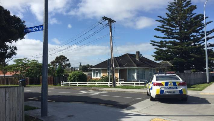 Police officers were still at the house on Saturday morning.