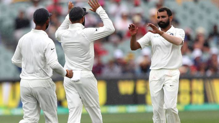 India's Mohammed Shami, right, is congratulated by team-mates after dismissing Australia's Travis Head.