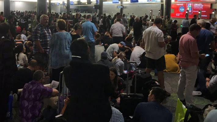 """Passengers were frustrated as a fire results in """"chaos"""" at Auckland International Airport."""