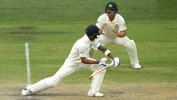 Virat Kohli of India is caught by Aaron Finch of Australia during day three.