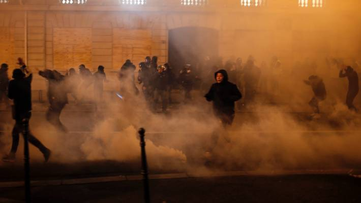 Crowds of yellow-vested protesters angry at President Emmanuel Macron and France's high taxes tried to converge on the presidential palace.