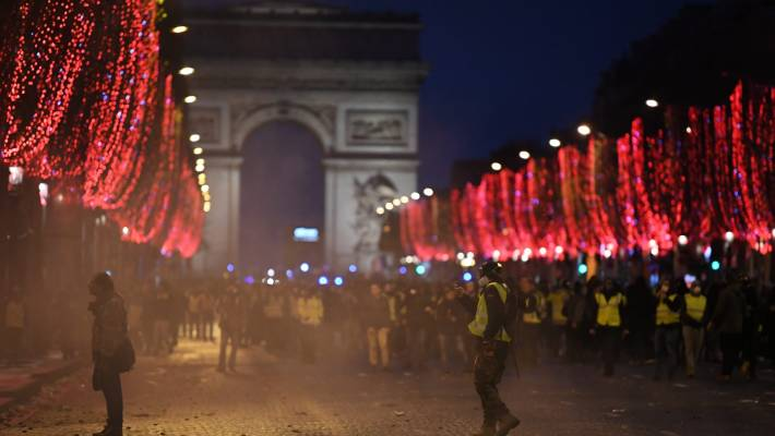 The lights of the Champs-Elysees glow as protesters demonstrate in the 'yellow vests' demonstration near the Arc de Triomphe.