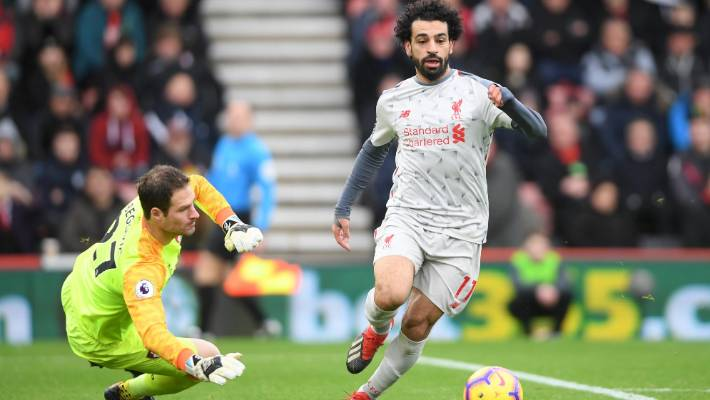 Mohamed Salah netted a hat-trick as Liverpool beat Bournemouth and shot to the top of the English Premier League.