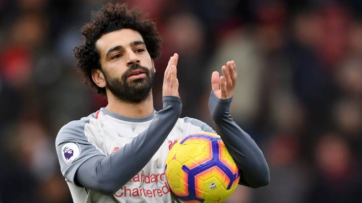 Mohamed Salah acknowledges the fans following his team's win away at Bournemouth.