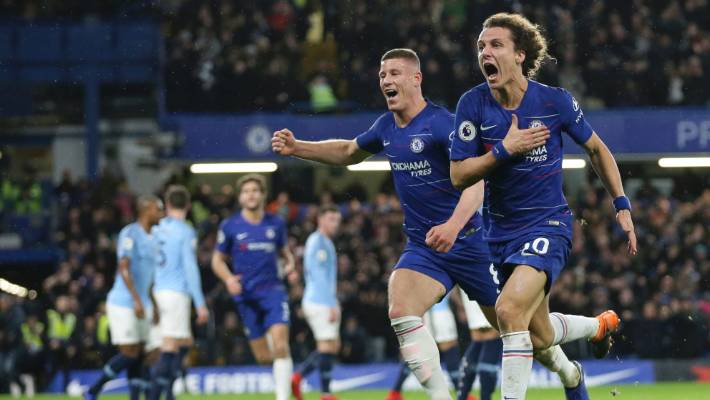 Chelsea's David Luiz, right, celebrates his goal which helped send Manchester City to their first defeat of the season.