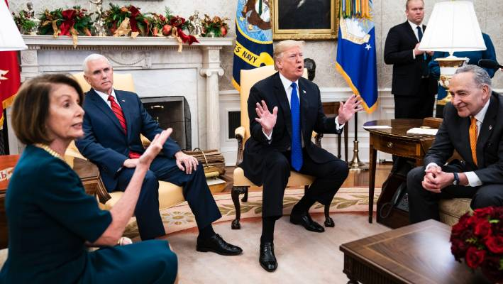 Donald Trump tussles with House Minority Leader Nancy Pelosi, left, and Senate Minority Leader Chuck Schumer, right, as Vice President Mike Pence listens during a meeting in the Oval Office.