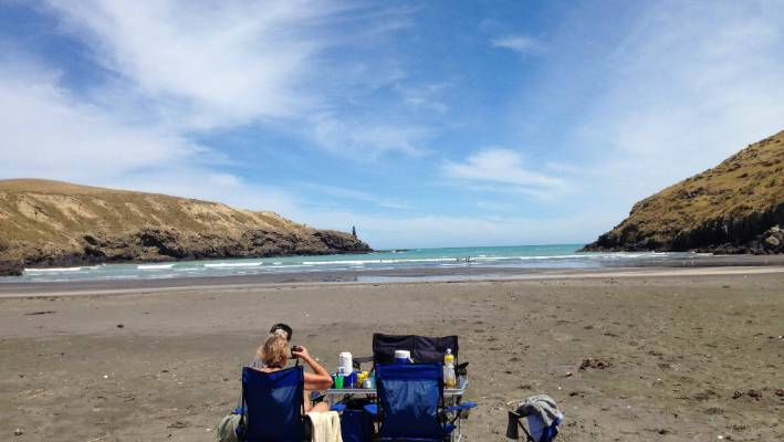 Tumbledown Bay, on the southern shores of Banks Peninsula, is a beach rarely visited by the crowds. Dreamy vistas of dry Canterbury hills dipping down into blue water awaits visitors to this gem.