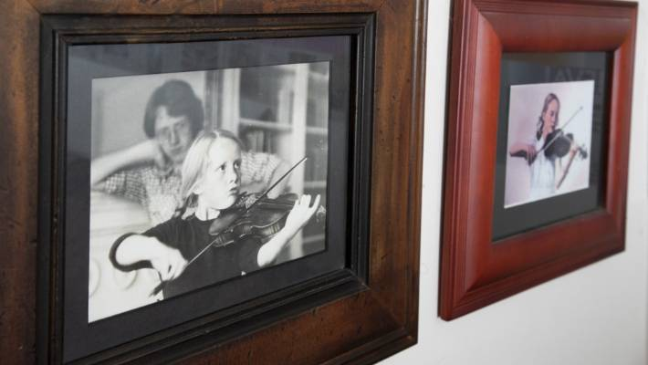 Sneyd, left, was lucky enough to learn early and with the support of her violin-playing mother (right-hand photo).