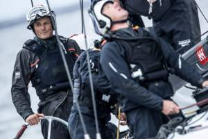 New Zealand sailor Dean Barker at the wheel of American Magic's test boat.