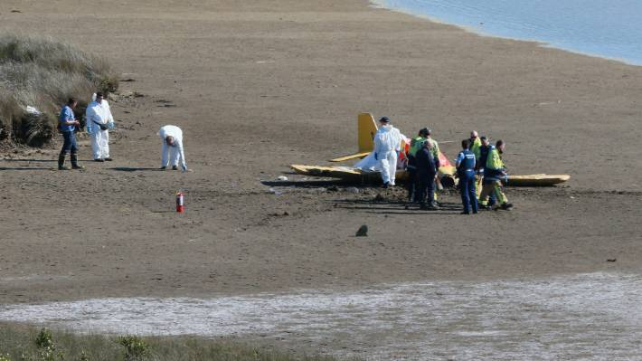 Emergency services at the scene of a fatal plane crash that killed two in Raglan on Monday.