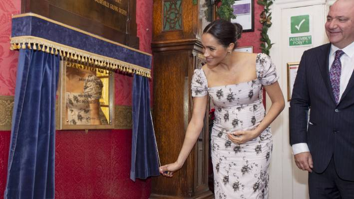 a very pregnant duchess meghan shows off growing bump while visiting nursing home stuff co nz a very pregnant duchess meghan shows