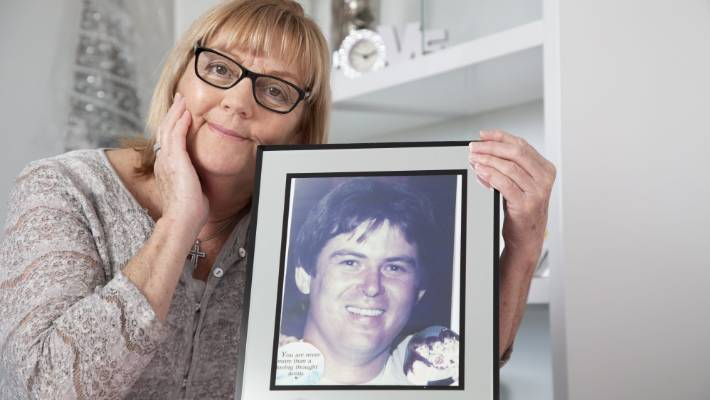 Debbie Magan with a photo of her husband Paul, who died in a US road smash in 1990.