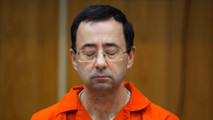 Nassar listening to his sentencing in court earlier this year.