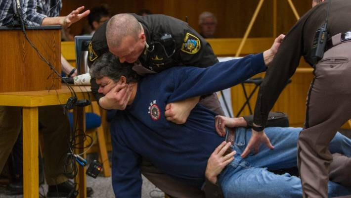 A father of three victims of Larry Nassar was restrained after the disgraced doctor in court.