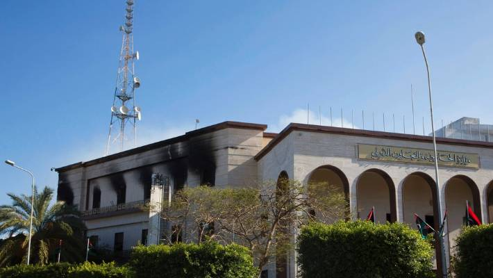 Fire damaged the foreign ministry building after a deadly attack in Tripoli. Security officials said a second attacker was shot dead by guards before he could detonate his explosive vest