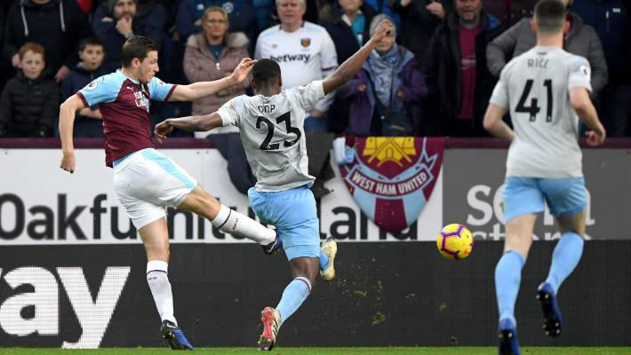 Burnley's Chris Wood scores under pressure from West Ham's Issa Diop