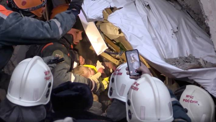 The baby boy survived for 35 hours after the building collapse in freezing temperatures thanks to being in a crib and wrapped up warmly