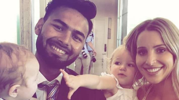 Indian cricketer Rishabh Pant pictured with Australian captain Tim Paine's wife, Bonnie, and their children.