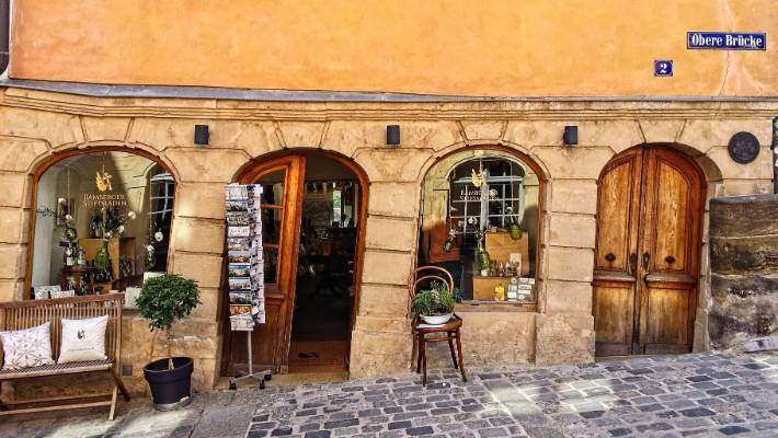This photo is of a souvenir shop on the approach to Obere Brucke, Bamberg, Germany.