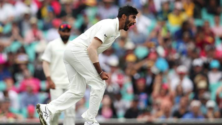 Jasprit Bumrah of India celebrates dismissing Peter Handscomb of Australia as the hosts plunged towards a big deficit on day four