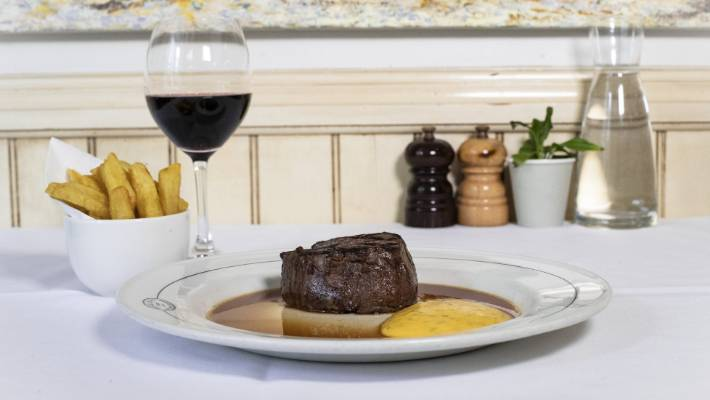 Boulcott St Bistro's signature dish, aged beef fillet with bearnaise, red wine jus, and hand-cut chips.