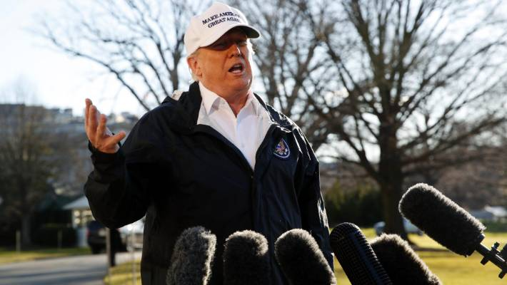 President Donald Trump speaks to the media en route for a trip to the border in Texas as the government shutdown continues