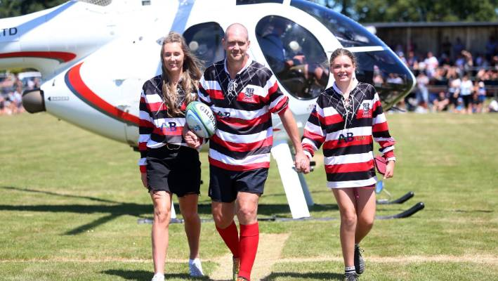 Blair Vining arrived by helicopter with daughters Della-May, 16, and Lilly, 12, for his bucket list rugby game in Winton at the weekend. Vining has terminal cancer and wanted to play one last game of rugby with his mates.