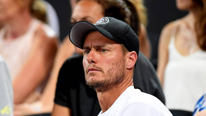 Lleyton Hewitt watches on during Alex De Minaur's win over Jo-Wilfried Tsonga of France in Sydney.