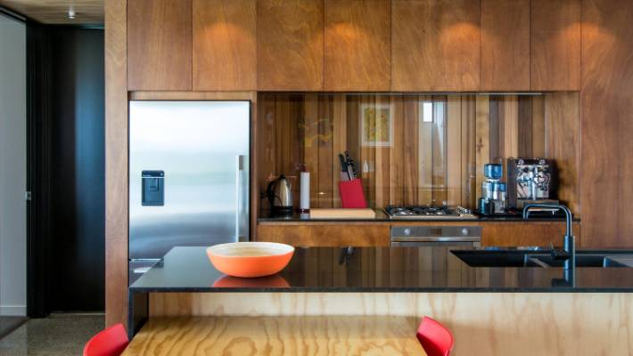 A sheet of glass over timber for your splashback gives warmth and is easier to clean than tiles.