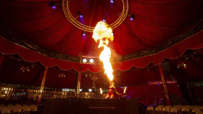 Fire eater Heather Holliday creates a giant fireball for the cabaret show LIMBO.