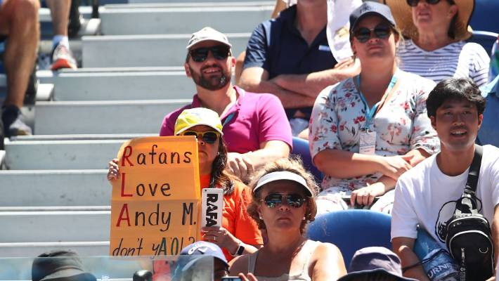 A Rafael Nadal fan shows support towards Andy Murray during the first round match between Rafael Nadal of Spain and James Duckworth of Australia at the Australian Tennis Open.
