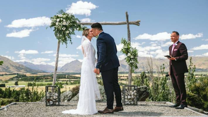 All Black hooker Codie Taylor and Canterbury Rugby player Lucy Ryan kiss during their wedding ceremony.
