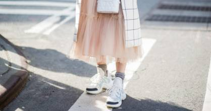 A woman wears Louis Vuitton sneakers in New York City. People's obsession with expensive, 'fashion' sneakers means many ...