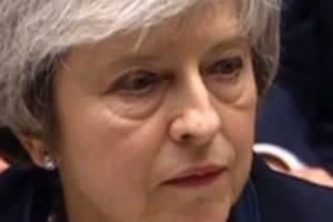 Britain's Prime Minister Theresa May speaks after losing a vote on her Brexit deal.