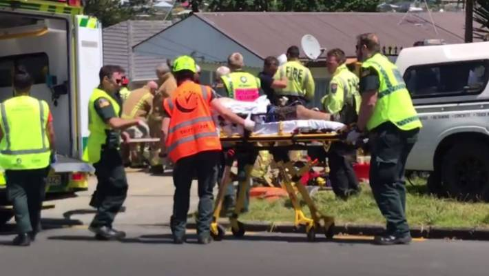 The man was removed from the trench by firefighters and loaded into an ambulance by paramedics.
