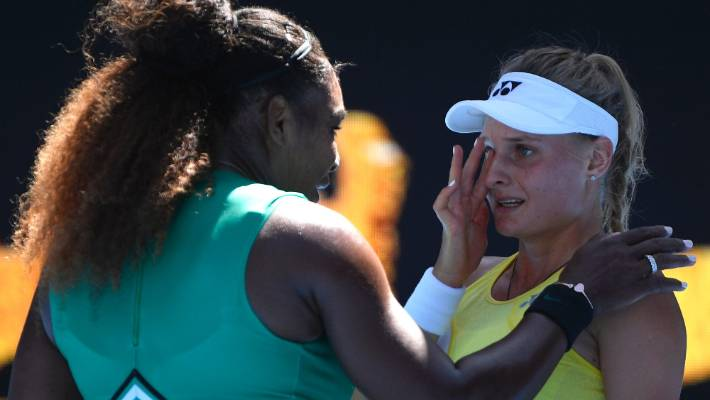 Serena Williams consoles Ukraine's Dayana Yastremska after winning their third round match at the Australian Open tennis championships in Melbourne