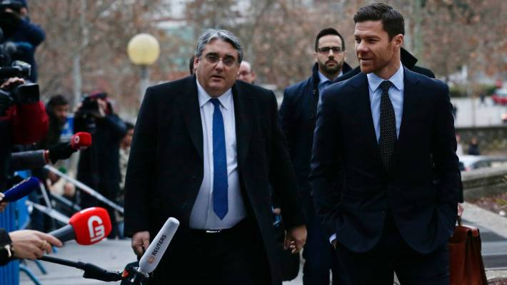 Former Real Madrid midfielder Xabi Alonso, right, arrives at the court in Madrid to face his own tax case.