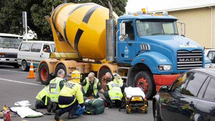 Motorbike hits concrete truck at red light outside Taranaki