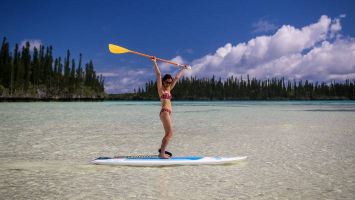 Paddleboarding on the Island of Pines.
