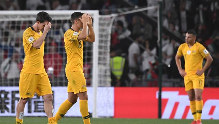 Australia's midfielder Christopher Ikonomid and Australia's midfielder Robbie Kruse hold their head after losing 1-0 to the United Arab Emirates.