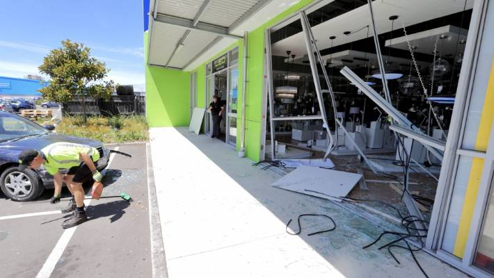 Car crashes through the front of Lighting Direct | Stuff co nz