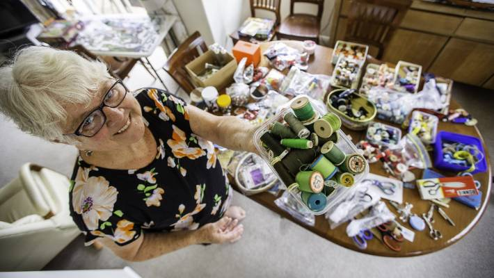 Red Cross volunteer Esmee Rowden, with sewing materials she has collected for refugee families.