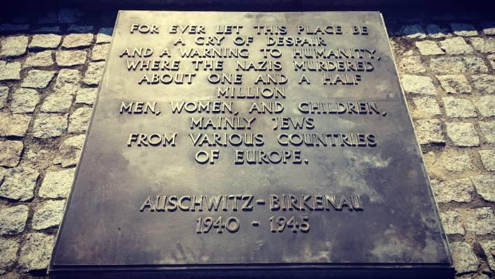 A plaque at the Auschwitz-Birkenau camp.