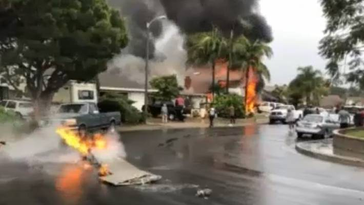 Small plane crashes into California suburb, burning houses